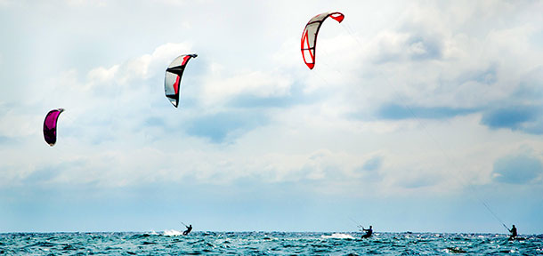 three-kitesurfers
